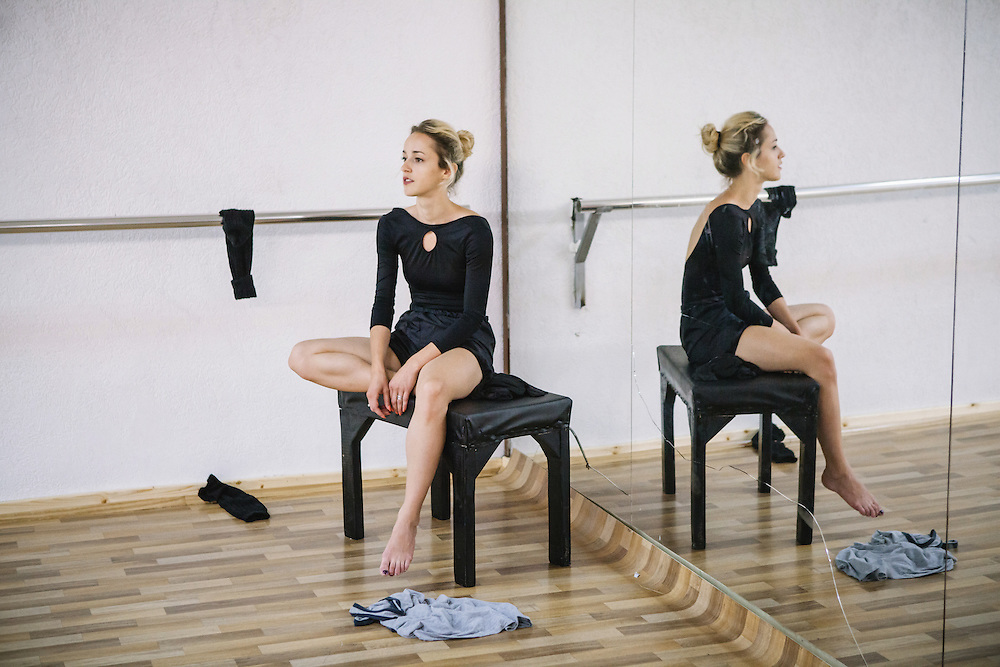 Vjollca Lugiqi, a prima ballerina of the Kosovo Ballet, having a break in the middle of a daily rehearsal in the training room at Kosovo National Theater, Prisitna.