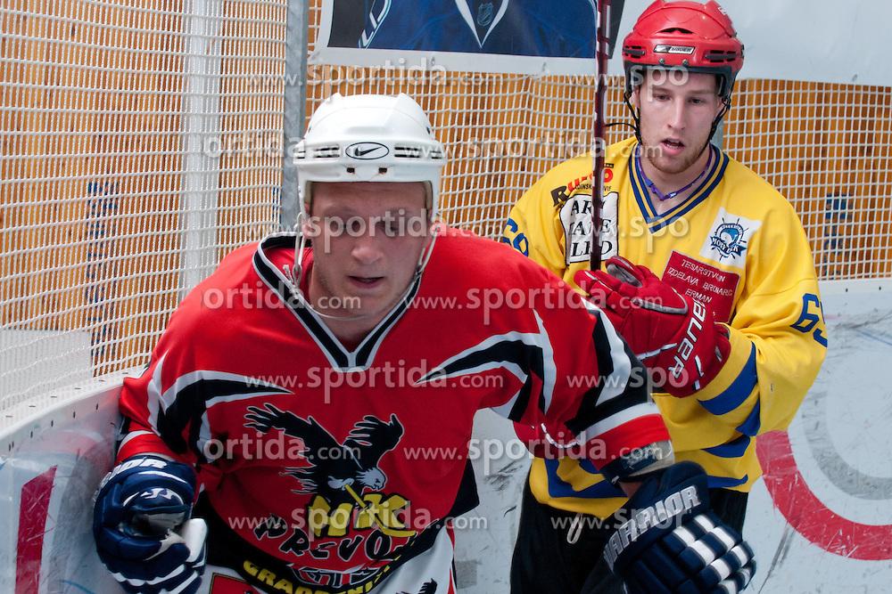 Jan Loboda of HK Prevoje and Robert Sabolic of Troha Pub Bled at final match of IZS Masters 2011 inline hockey between Troha Pub Bled and HK Prevoje, on June 4, 2011 in Sportni park, Horjul, Slovenia. (Photo by Matic Klansek Velej / Sportida)