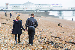 © Licensed to London News Pictures. 07/12/2019. Brighton, UK. A handful of people can be seen taking to the beach in Brighton and Hove as milder weather is hitting the seaside resort. Photo credit: Hugo Michiels/LNP