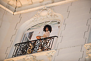 Lady Gaga greets her audience from the window of her hotel in Brussels