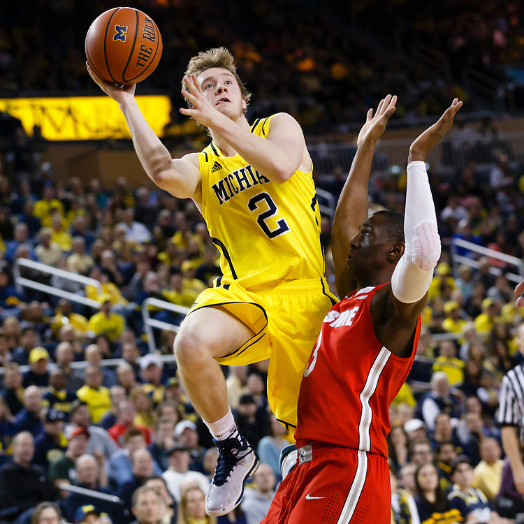 Feb 22, 2015; Ann Arbor, MI, USA; Michigan Wolverines guard Spike Albrecht (2) looks to shoots the ball over Ohio State Buckeyes guard Shannon Scott (3) in the first half at Crisler Center. Mandatory Credit: Rick Osentoski-USA TODAY Sports
