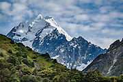 See the peak of Aoraki / Mount Cook (3755 meters / 12,349 feet) from Sealy Tarns Track, in Aoraki / Mount Cook National Park, Canterbury region, South Island, New Zealand. In 1990, UNESCO honored Te Wahipounamu - South West New Zealand as a World Heritage Area.