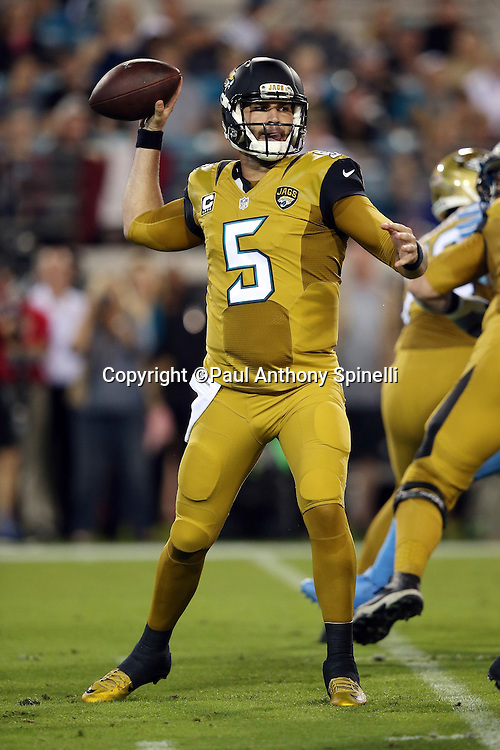 Jacksonville Jaguars quarterback Blake Bortles (5) throws a first quarter pass for a gain of 6 yards during the 2015 week 11 regular season NFL football game against the Tennessee Titans on Thursday, Nov. 19, 2015 in Jacksonville, Fla. The Jaguars won the game 19-13. (©Paul Anthony Spinelli)