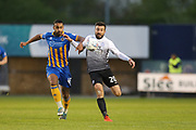 45 Stefan Payne for Shrewsbury Town and  20 Michael Doughty for Peterborough United during the EFL Sky Bet League 1 match between Shrewsbury Town and Peterborough United at Greenhous Meadow, Shrewsbury, England on 24 April 2018. Picture by Graham Holt.