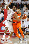 FAYETTEVILLE, AR - NOVEMBER 30:  Michael Carter-Williams #1 of the Syracuse Orangemen is guarded by Rashad Madden #00 of the Arkansas Razorbacks at Bud Walton Arena on November 30, 2012 in Fayetteville, Arkansas.  The Orangemen defeated the Razorbacks 91-82.  (Photo by Wesley Hitt/Getty Images) *** Local Caption *** Michael Carter-Williams; Rashad Madden