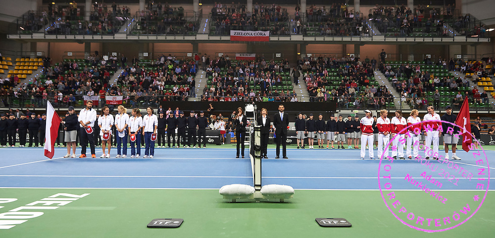 (L) Team of Poland and (R) (R) team of Switzerland while opening ceremony during the Fed Cup / World Group Play Off tennis match between Poland and Switzerland on April 18, 2015 in Zielona Gora, Poland<br /> Poland, Zielona Gora, April 18, 2015<br /> <br /> Picture also available in RAW (NEF) or TIFF format on special request.<br /> <br /> For editorial use only. Any commercial or promotional use requires permission.<br /> <br /> Adam Nurkiewicz declares that he has no rights to the image of people at the photographs of his authorship.<br /> <br /> Mandatory credit:<br /> Photo by &copy; Adam Nurkiewicz / Mediasport