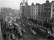 13/11/1954<br /> 11/13/1954<br /> 13 November 1954<br /> Traffic scenes on Westmoreland Street, Dublin - Special for C.I.E.bicycles, cars, busses, o'connell bridge,<br /> 643-8747,