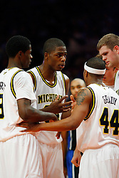 Nov 21, 2008; New York, NY, USA; Michigan Wolverines forward DeShawn Sims (34) talks with his teammates during the 2K Sports Classic Championship game at Madison Square Garden. Duke won 71-56.