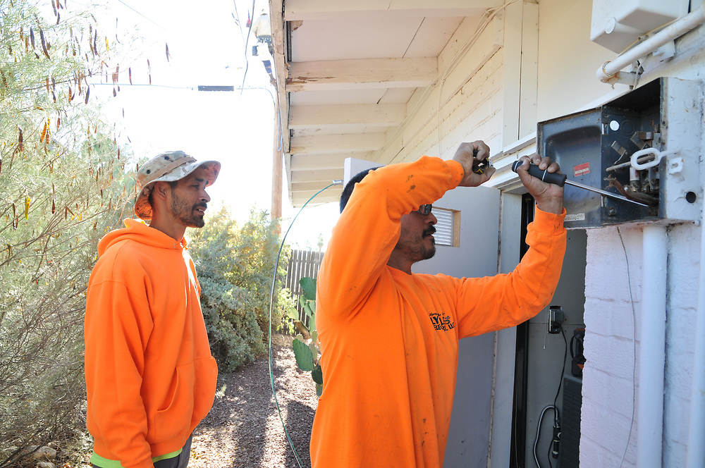 Lytle Electric worker dismantles main breaker for 60 amp service