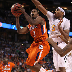 Mar 17, 2011; Tampa, FL, USA; Clemson Tigers guard Zavier Anderson (3) shoots over West Virginia Mountaineers forward Kevin Jones (5) during the first half of the second round of the 2011 NCAA men's basketball tournament at the St. Pete Times Forum.  Mandatory Credit: Derick E. Hingle