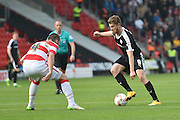 Sam Winnall of Barnsley FC against Luke McCullough of Doncaster Rovers during the Sky Bet League 1 match between Doncaster Rovers and Barnsley at the Keepmoat Stadium, Doncaster, England on 3 October 2015. Photo by Ian Lyall.