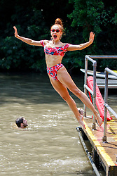 © Licensed to London News Pictures. 01/07/2018. London, UK. Emily Bracewell swims in Hampstead Heath Mixed Bathing Pond in north London on Sunday, July 1, 2018 as heatwave has reached 31C and is set to continue into the next week and the unusually high temperatures look set to remain until the week after next. Photo credit: Tolga Akmen/LNP