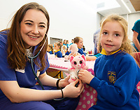 18/01/2018 Med Student Eimear Curran from Cork with Aisling Morrin from Oranmore and her teddy &quot;camouflage&quot;<br />   at the Teddy Bear Hospital at NUI Galway. Students get used to dealing with Kids and Kids get a Hospital experience with a difference. Photo:Andrew Downes, XPOSURE
