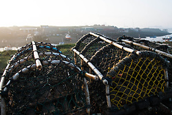 © Licensed to London News Pictures. 13/03/2014<br /> <br /> South Gare, Teesside, England, UK<br /> <br /> Lobster pots are stacked up at South Gare on the mouth of the River Tees on Teesside.<br /> <br /> Photo credit : Ian Forsyth/LNP