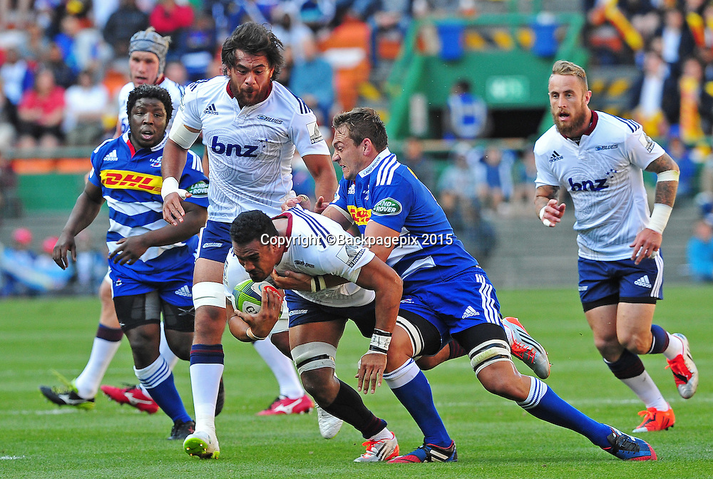Francis Saili of the Blues is tackled by Rynhardt Elstadt of the Stormers during the 2015 Vodacom Super Rugby game between the Stormers and the Blues at Newlands Rugby Stadium, Cape Town on 21 February 2015 ©Ryan Wilkisky/BackpagePix
