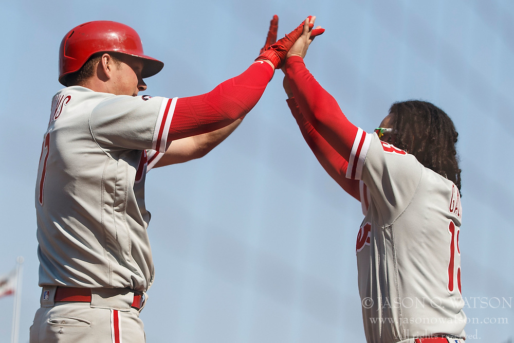 SAN FRANCISCO, CA - AUGUST 20: Rhys Hoskins #17 of the Philadelphia Phillies is congratulated by Freddy Galvis #13 after hitting a home run against the San Francisco Giants during the ninth inning at AT&T Park on August 20, 2017 in San Francisco, California. The Philadelphia Phillies defeated the San Francisco Giants 5-2. (Photo by Jason O. Watson/Getty Images) *** Local Caption *** Rhys Hoskins; Freddy Galvis