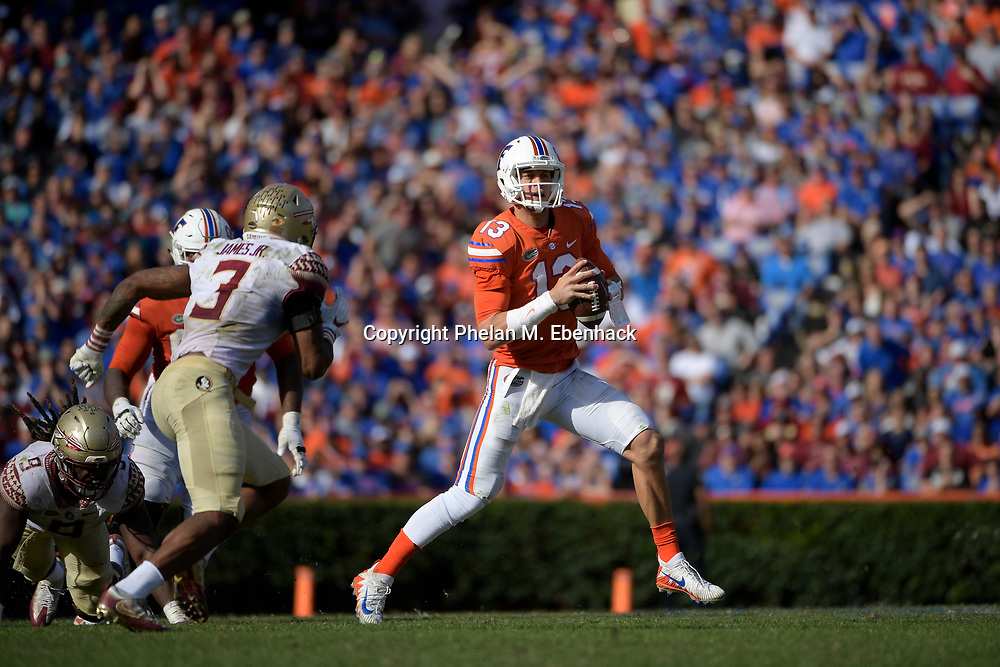 Florida quarterback Feleipe Franks (13) sets up to throw a pass in front of Florida State defensive back Derwin James (3) during the second half of an NCAA college football game Saturday, Nov. 25, 2017, in Gainesville, Fla. FSU won 38-22. (Photo by Phelan M. Ebenhack)