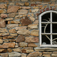 Antlers and skulls can be seen through a window in a stone wall at Settlement Harbour on New Island, Falkland Islands.