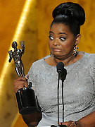 Octavia Spencer reacts to the weight of the Actor statue. The 18th Annual Screen Actors Guild Awards were held at the Shrine Exposition Center in Los Angeles, CA 1/29/2012(John McCoy/Staff Photographer)