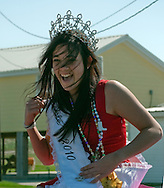Miss Grand Isle, Harleigh Duplantis, laughs as she tries to keep her sash from blowing away during the annual Mardi Gras parade March 6, 2011 in Grand Isle, La. The island was heavily impacted by the Deepwater Horizon oil spill April 20, 2010 and continues to recover. (Photo by Carmen K. Sisson)