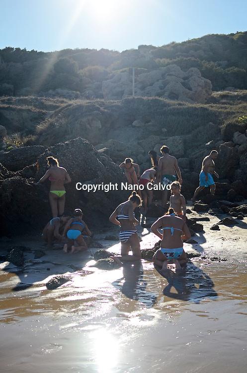 People apply muds on Bolonia beach, Tarifa