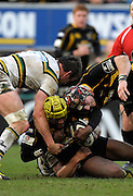 Wycombe, GREAT BRITAIN,   In the mix, Wasps', Serge BETSEN, pulled to the ground during the Guinness Premiership rugby game, London Wasps vs Northampton Saints, at Adam's Park Stadium, Bucks, England, on Sun 22.02.2009. [Photo, Peter Spurrier/Intersport-images]