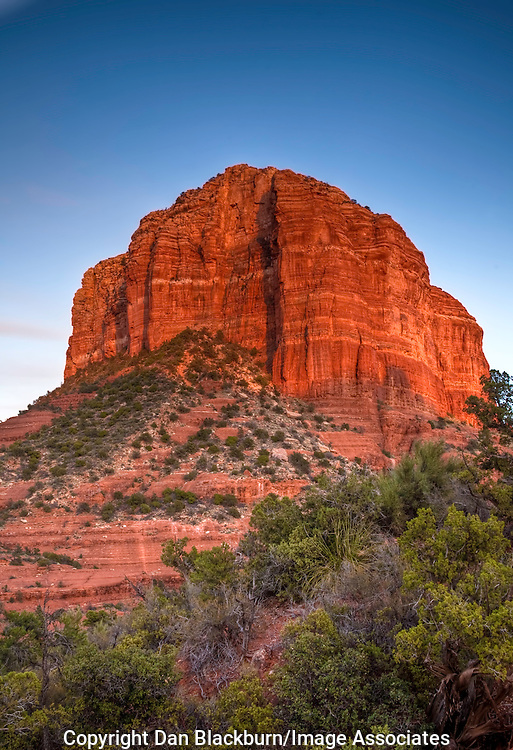 The Setting Sun Lights Up the Red Rock Formation Known as Courthouse Butte in Sedona, Arizona.