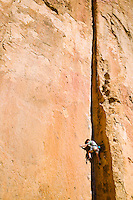 "A man lead climbing ""Lion's Chair"", a climbing rout at Smith Rock State Park in central Oregon, USA."