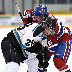 LINDSAY, ON - Feb 14 : Ontario Junior Hockey League Game Action between the Lindsay Muskies and the Toronto Jr. Canadiens, Logan DeNoble #28 of the Lindsay Muskies Hockey Club battles for the puck with Aaron Spivak #25 of the Toronto Jr. Canadiens Hockey Club during third period game action.<br /> (Photo by Andy Corneau / OJHL Images)