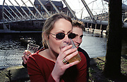 A couple drinking by a river, UK 2000's