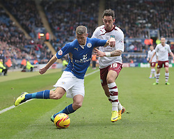 Leicester City's Paul Konchesky is challenged by Burnley's Danny Ings - Photo mandatory by-line: Nigel Pitts-Drake/JMP - Tel: Mobile: 07966 386802 14/12/2013 - SPORT - Football - Leicester - King Power Stadium - Leicester City v Burnley - Sky Bet Championship