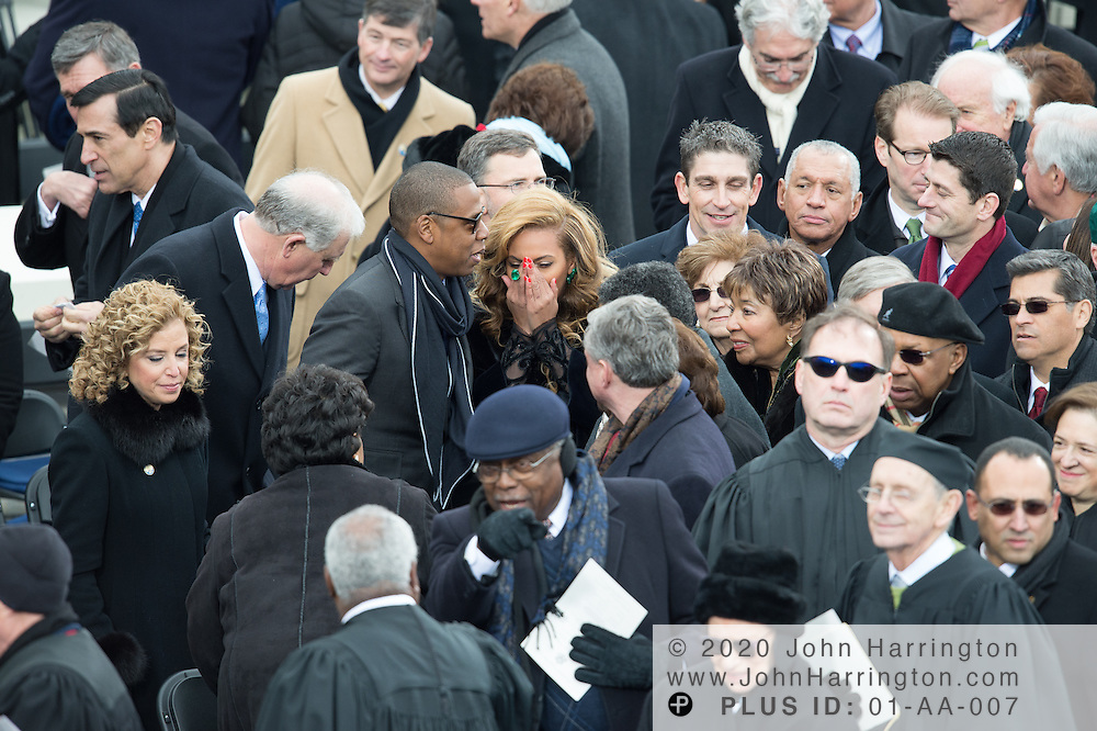 Jay-Z and Beyonce as she coughs at the conclusion of the 57th Presidential Inauguration of President Barack Obama at the U.S. Capitol Building in Washington, DC January 21, 2013.