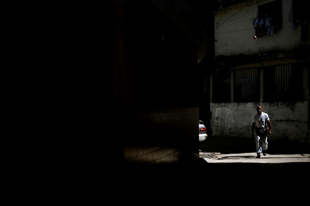 Blackout in the Catia slum in Caracas, Venezuela. People living in Venezuelan slums are faced daily with inadequate municipal services, including blackouts, water shortages, poor roads and an unreliable waste management system.