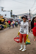 a woman sells fish from a basket, duong dong morning market