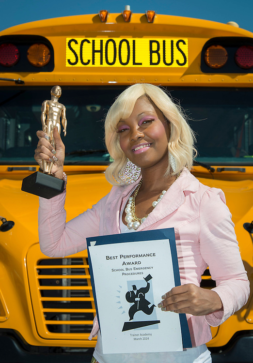 Houston ISD bus driver Tomeka Criswell-Brooks poses for a photograph with her awards from the Trainer Academy, March 12, 2014.
