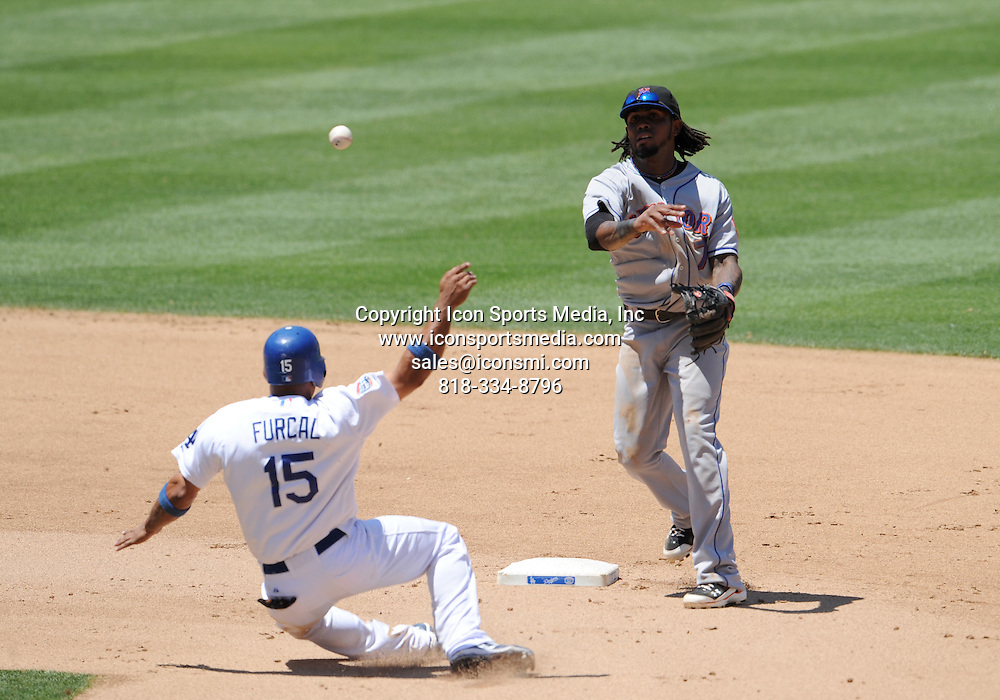24 July 2010: Mets #7 Jose Reyes turns to first for a double play against Dodgers #15 Rafael Furcal  during a Major League Baseball game between the New York Mets and the Los Angeles Dodgers at Dodger Stadium, in Los Angeles, CA.