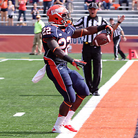 Illinois running back Dami Ayoola #22 escapes the pile up to run for a touchdown at Memorial Stadium, Champaign, Illinois, September 15, 2012. George Strohl/AI Wire.