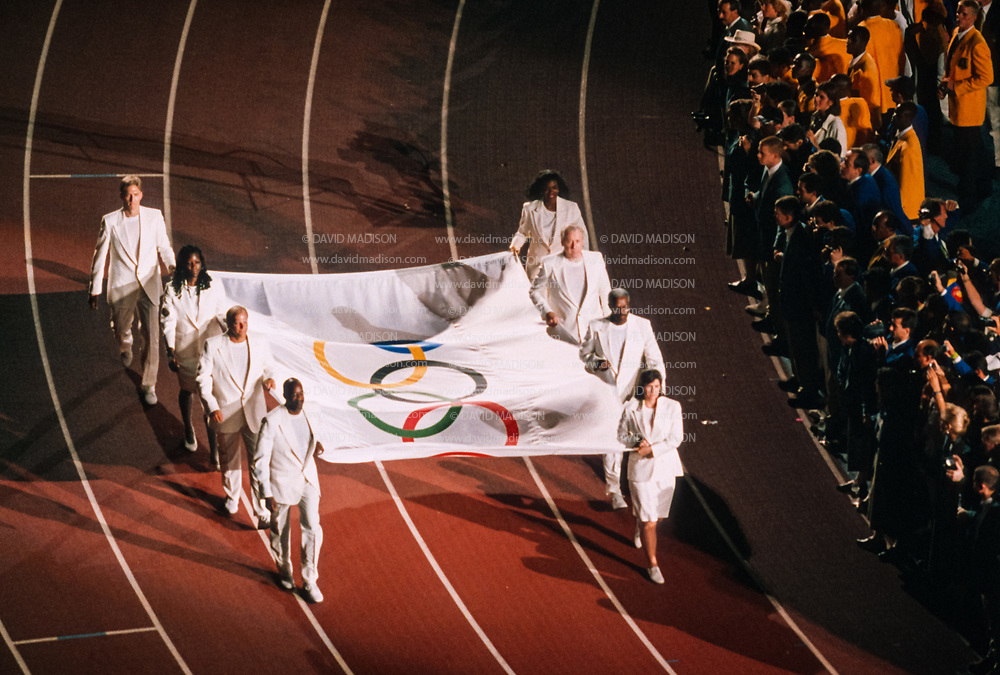 ATLANTA - JULY 19:  The Olympic Flag is carried during the Opening Ceremony of the 1996 Olympic Games takes place on July 19, 1996 in Centennial Olympic Stadium in Atlanta, Georgia.  (Photo by David Madison/Getty Images)