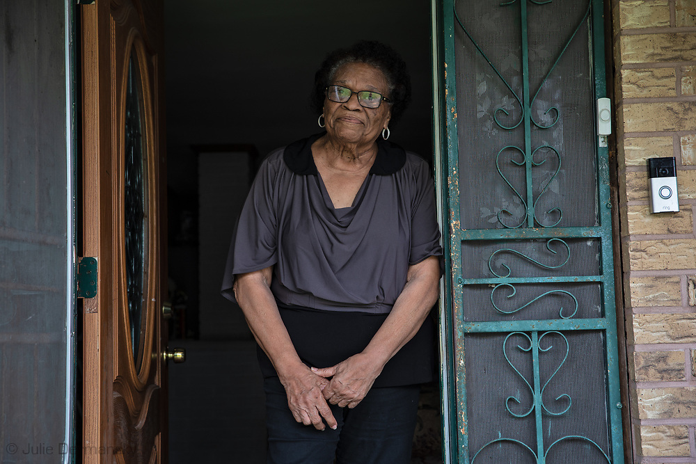 """Mary Hampto, the president of the Concerned Citizens of St. John the Baptist Parish, inside her front door on her 81st birthday, after attending a funeral: """"The situation is scary because people are dying all around. Our immune systems are compromised due to all the pollution here.  Everybody I know has respiratory illnesses. We are more susceptible to getting this. Between all of the chemicals and the virus, we are doomed. I am sitting here waiting to die."""""""