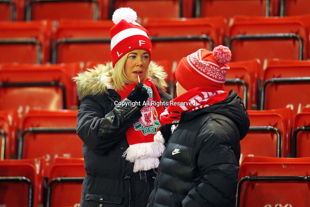 20.01.2015.  Anfield, Liverpool, England. Capital One Cup Semi Final. Liverpool versus Chelsea. A Liverpool supporter puts a bit of lip gloss on