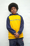 Little boy with an afro wearing a hoodie