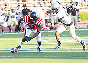 Samford defensive back Alvin Hines II goes for the ball that was fumbled by Wofford running back to end the game in overtime  at Seibert Stadium in Homewood, Ala., Saturday, Oct 13, 2012. Samford defeats Wofford 24-17 in Overtime. (Marvin Gentry)