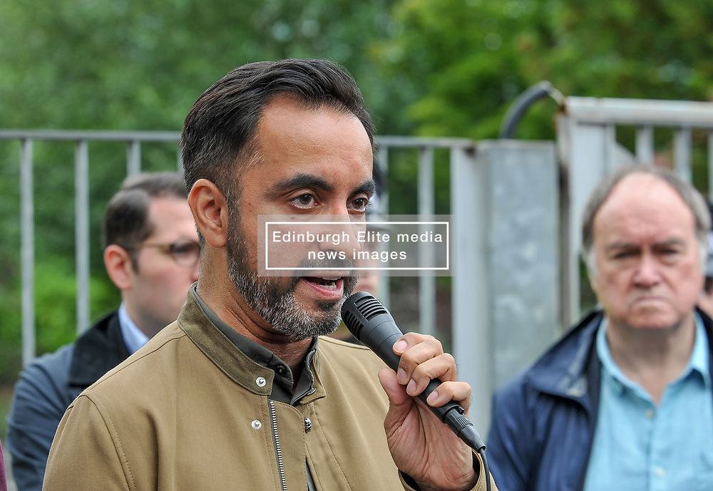 Pictured: Human rights lawyer Aamer Anwar talks to the demonstrators.<br /> <br /> Protesters gathered outside the main Home Office building in Glasgow to protest at private company SERCO's attempts to evict failed asylum seekers from their homes.<br /> <br /> © Dave Johnston / EEm