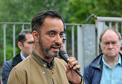 Pictured: Human rights lawyer Aamer Anwar talks to the demonstrators.<br /> <br /> Protesters gathered outside the main Home Office building in Glasgow to protest at private company SERCO's attempts to evict failed asylum seekers from their homes.<br /> <br /> &copy; Dave Johnston / EEm