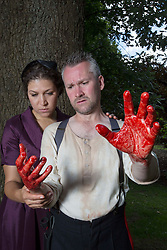 Pictured:  <br /> Bard in the Botanics . The latest production features a version of Macbeth set in 1950s, directed by Gordon Barr. Kirk Bage (Macbeth) and Nicole Cooper (Lady Macbeth) have blood on their hands as they perform the murder of Duncan scene on the main stage<br /> Karen Gordon  (c) Edinburgh Elite media Date<br /><br /><br />(c) Karen Gordon | Edinburgh Elite media