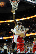Apr 19, 2010; Cleveland, OH, USA; Cleveland Cavaliers center Shaquille O'Neal (33) shoots over Chicago Bulls center Brad Miller (52) during the second period in game two in the first round of the 2010 NBA playoffs at Quicken Loans Arena. Mandatory Credit: Jason Miller-US PRESSWIRE