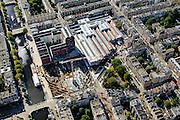 Nederland, Noord-Holland, Amsterdam, 27-09-2015; stadsdeel Amsterdam-West (Kinkerbuurt). Cultureel centrum De Hallen, met onder andere bibliotheek, theater, bioscoop de Filmhallen. Voormalige Remise Tollensstraat. Andere straten onder andere Kinkerstraat, Bilderdijkkade, Bellamyplein en Ten Katestraat. De bouwput is van het project de Hallen Zuid en de Hallen Noord.<br /> Cultural center De Hallen, including library, theater, cinema. Former tram shed.<br /> <br /> luchtfoto (toeslag op standard tarieven);<br /> aerial photo (additional fee required);<br /> copyright foto/photo Siebe Swart