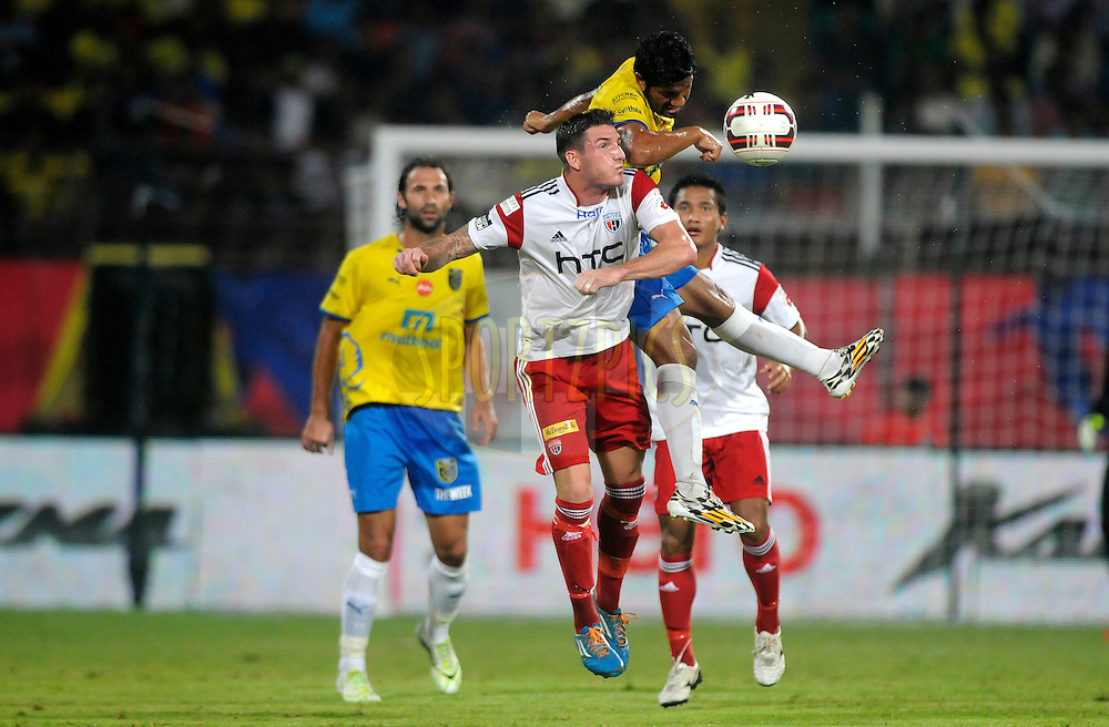James Keene of NorthEast United FC and Gurwinder Singh of Kerala Blasters FC during match 49 of the Hero Indian Super League between Kerala Blasters FC and North East United FC held at the Jawaharlal Nehru Stadium, Kochi, India on the 30th November.<br /> <br /> Photo by:  Pal Pillai/ ISL/ SPORTZPICS