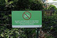 Signage in Central Park: DO NOT LOCK BICYCLES TO THE FENCE