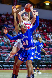 NORMAL, IL - January 03:  Sandwiched between a pair of Sycamore defenders including Caitlin Anderson, Lexi Wallen still manages to offer a shot during a college women's basketball game between the ISU Redbirds and the Sycamores of Indiana State January 03 2020 at Redbird Arena in Normal, IL. (Photo by Alan Look)